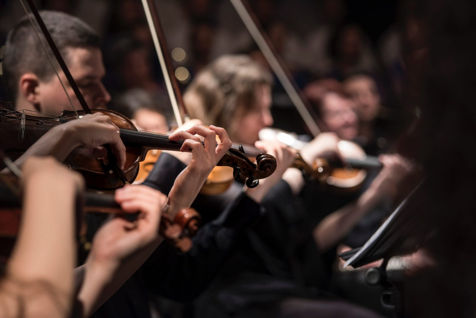 Image of orchestra playing to illustrate the metaphor of play in a professional environment
